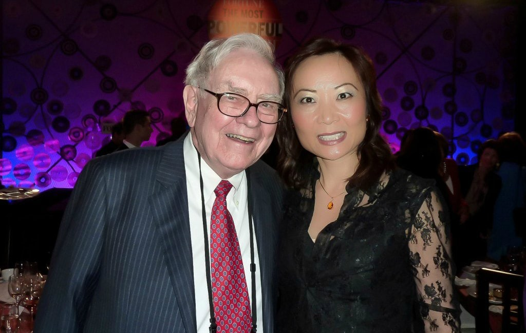 Warren Buffett Jing Ulrich together business meeting conference