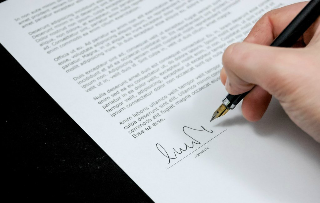founder agreement template draft paper pen signature written
