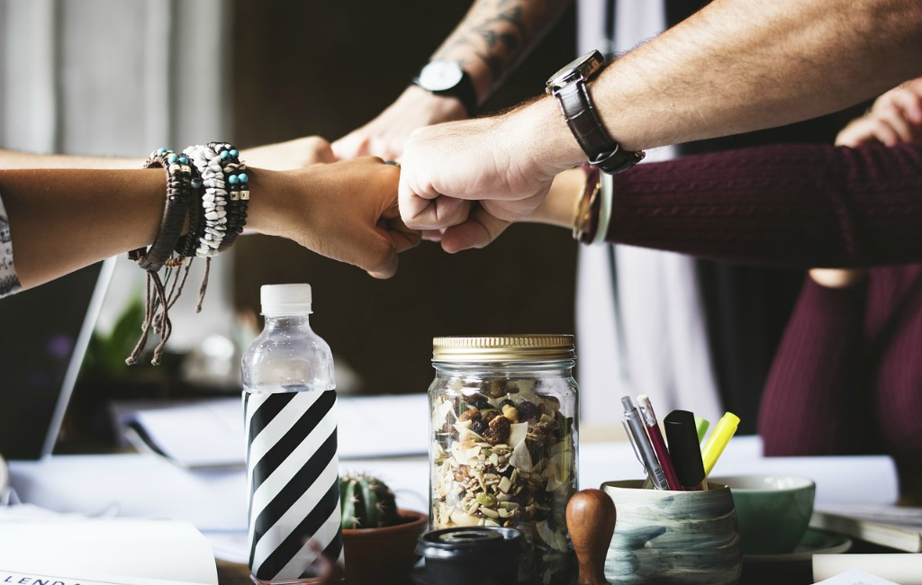 team building join hands take action professionals office fist
