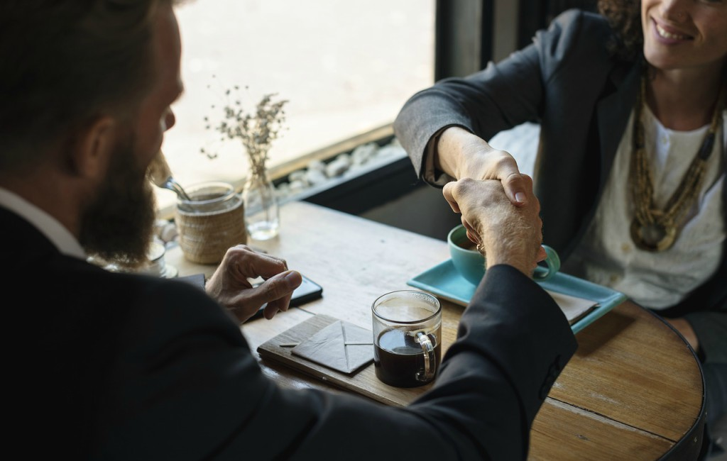 sales person shake hands to crack deal with prospect