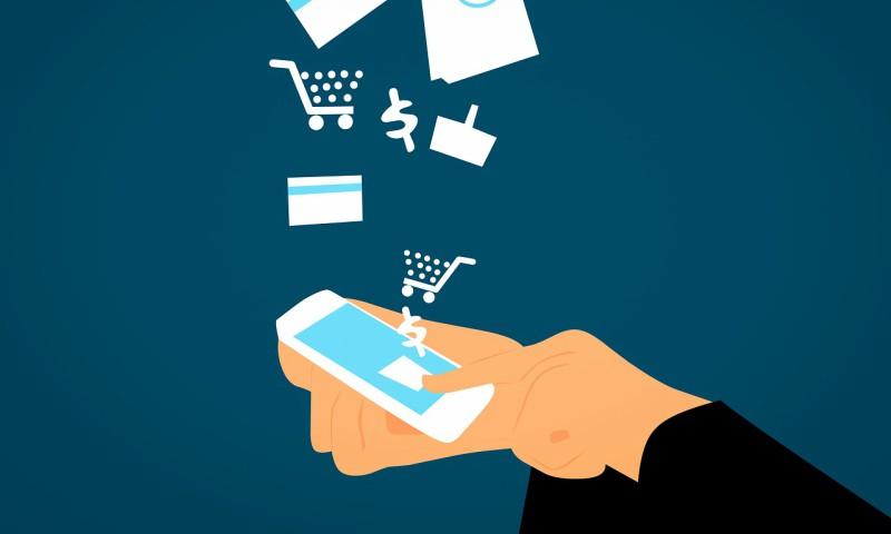man buying online with mobile visa shopping kart