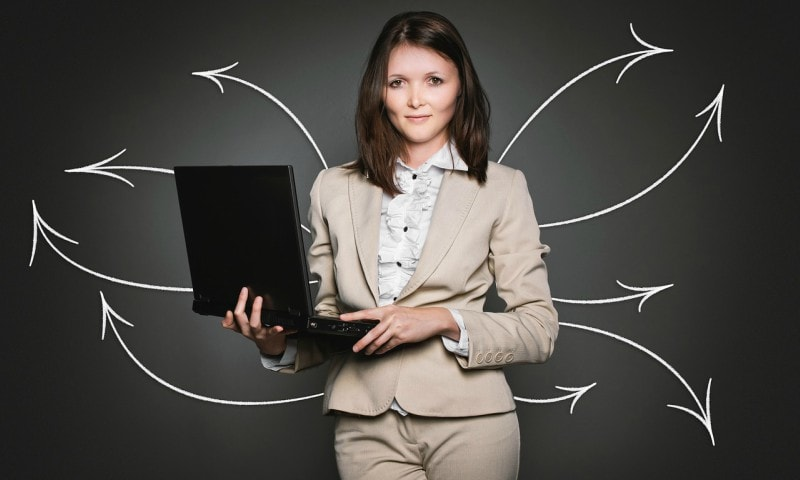 girl with laptop, sales girl, beautiful girl giving presentation, sales techniques