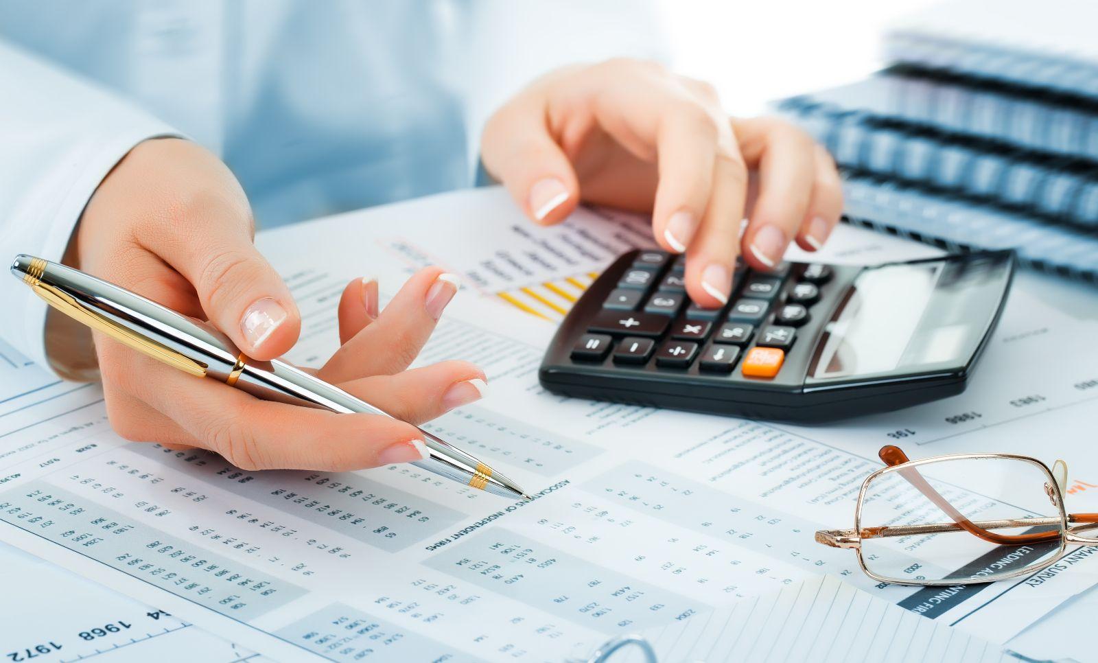 audit professional man working, man working, pen in hand