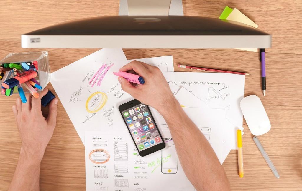 idea development making notes apple laptop iphone paper writing designing
